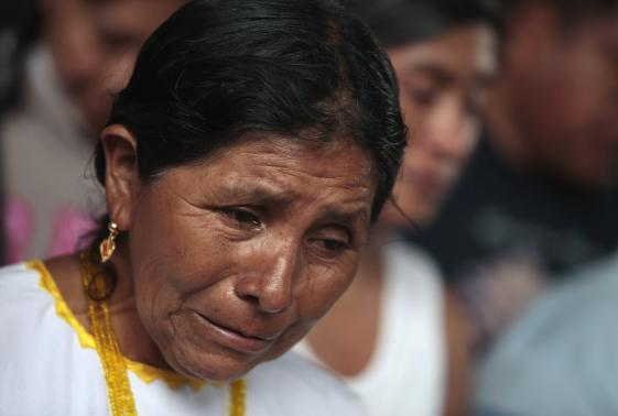 "A relative of one of the missing students from Ayotzinapa Teacher Training College ""Raul Isidro Burgos"" cries during prayers at the basketball court in the school at a private mass in Tixtla"